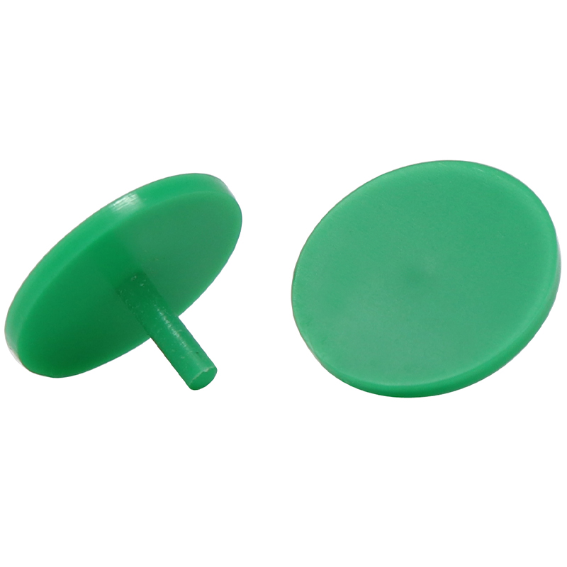 2 green plastic golf ball markers