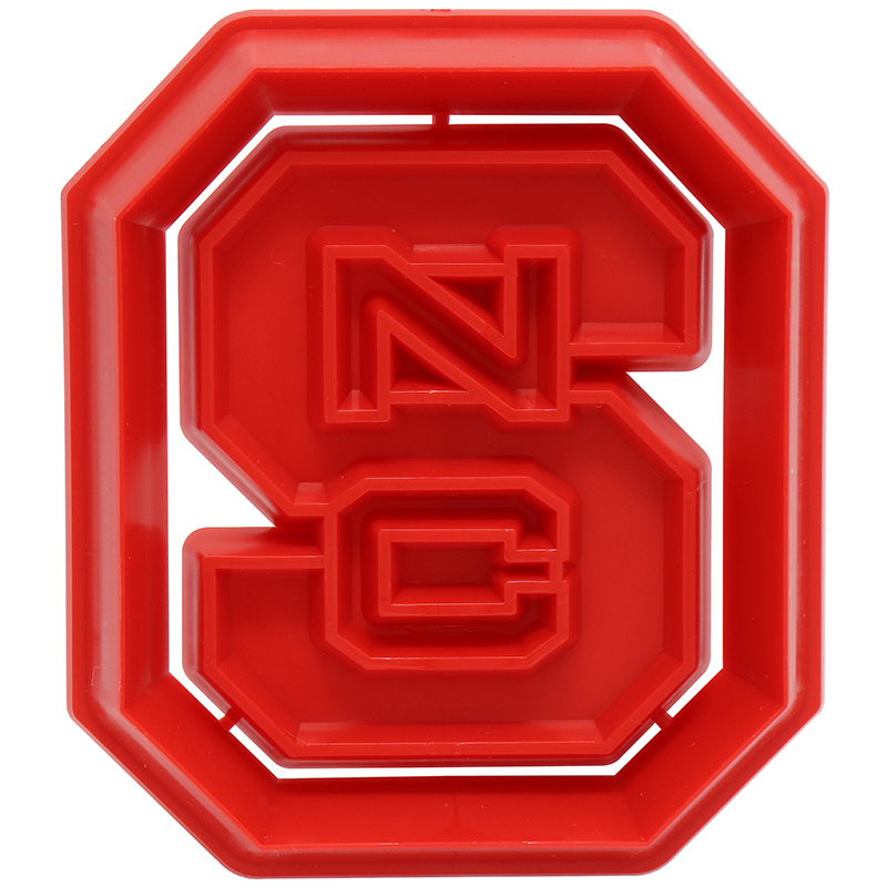 "Red S shaped cookie cutter with the letters ""NC"" in the middle"