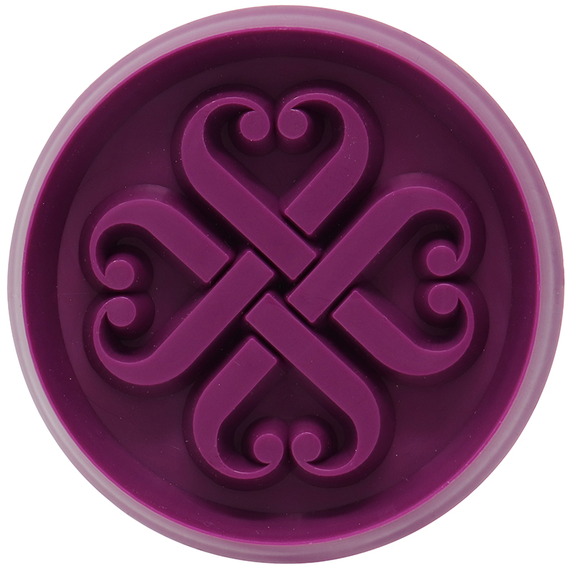 Purple circle shaped cookie cutter with design in the middle