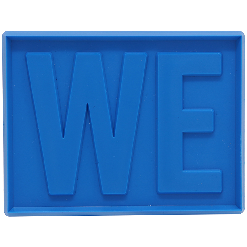 "Blue square shaped cookie cutter with the letters ""WE"""