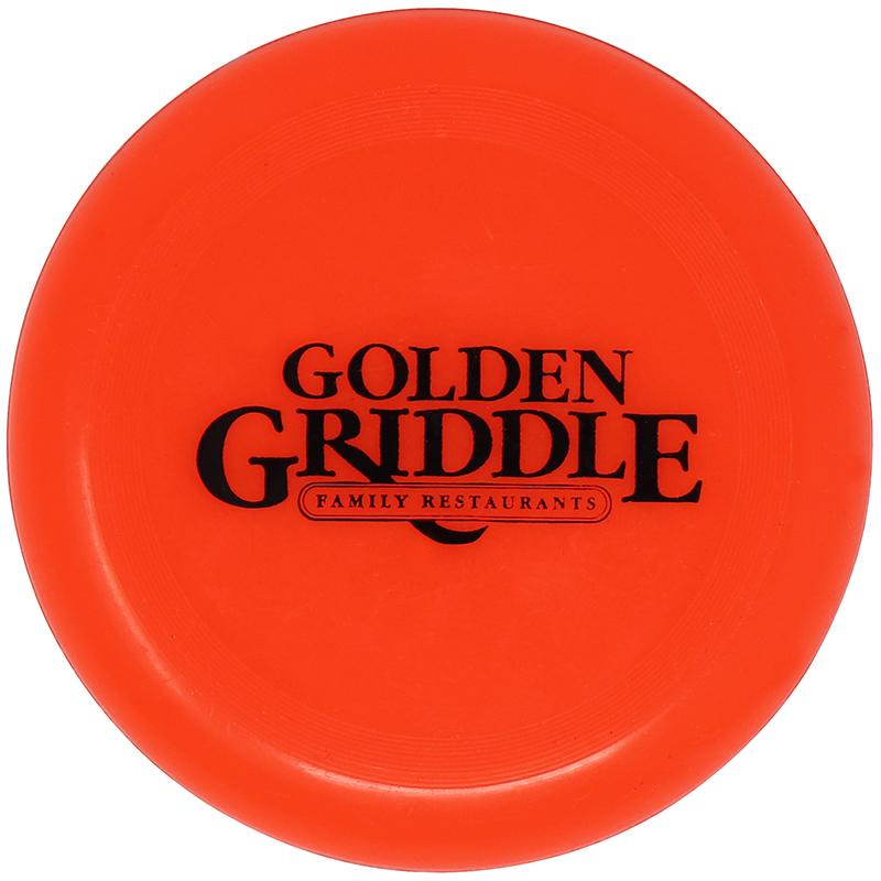 Plastic orange flying disc with the Golden Griddle logo