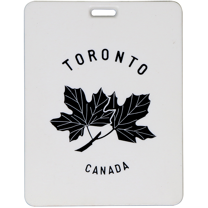 "Rectangle plastic white bag tag with the words ""Toronto Canada"""