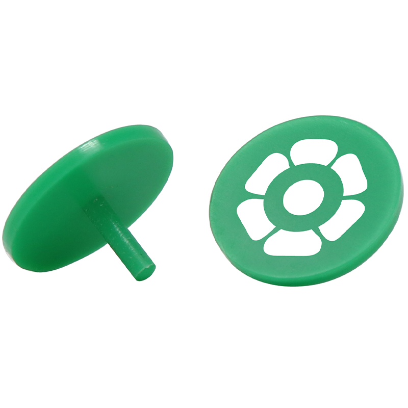 2 green plastic golf ball markers with a golf flag image in the middle