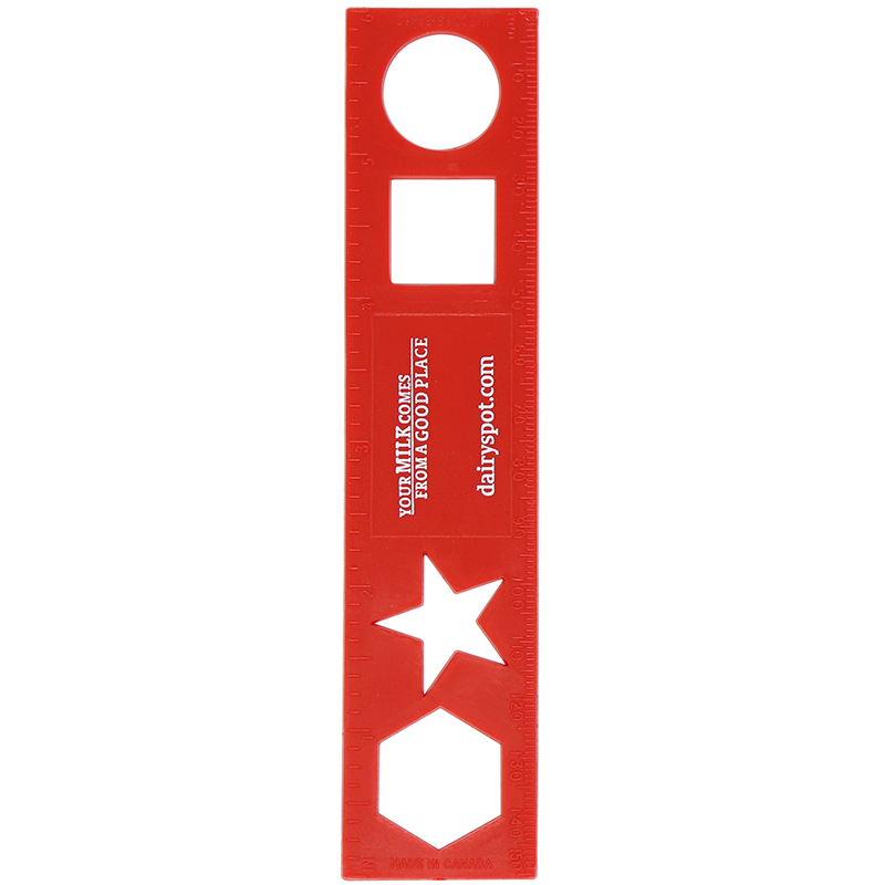Red plastic ruler with shapes in ruler