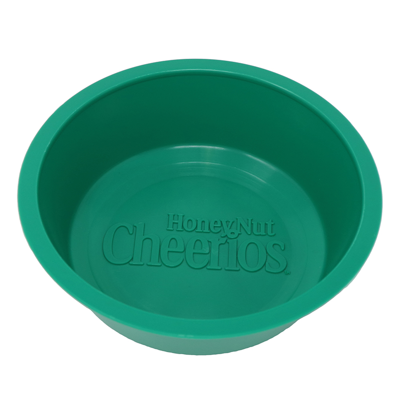 "Green plastic bowl with the words ""Cheerios"""