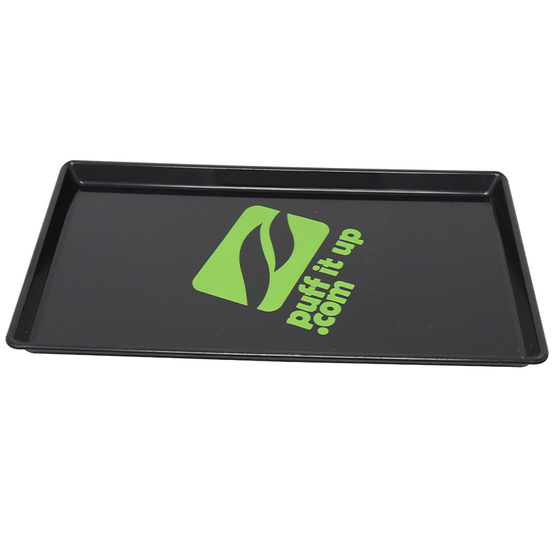 Black plastic tip tray with green logo on it