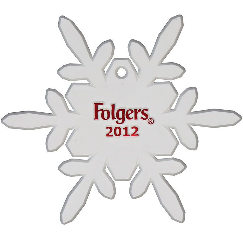 White plastic shaped snowflake with the Folgers logo
