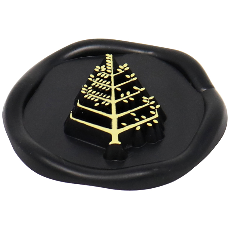 Black plastic wax seal with a gold tree in the middle