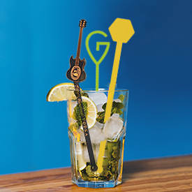 3 Custom Plastic Stir Sticks in a glass/drink